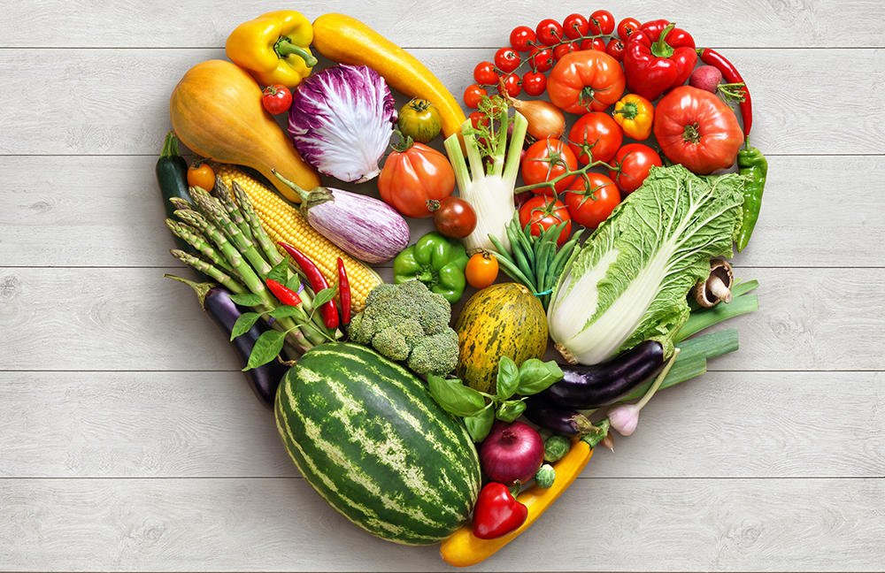 Photo of fruit and vegetables arranged in a heart shape