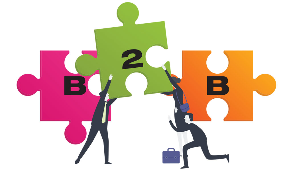 Illustration of businessmen putting puzzle pieces labelled 'B2B' together