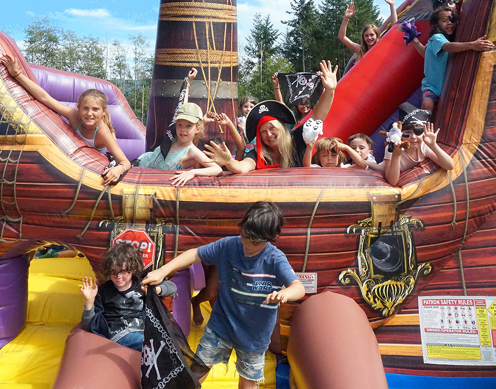 Photo of kids playing on an inflatable pirate ship