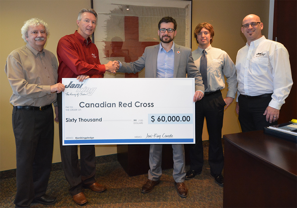 Photo of a cheque presentation by Jani-King to the Canadian Red Cross