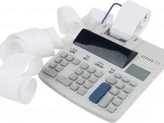 Photo of an adding machine with unravelling paper