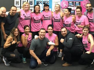 Group photo of women in pink shirts supporting 30 Minute Hit's Kick Cancer charity