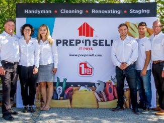 Photo of Prep 'n Sell franchise team in white shirts by Prep 'n Sell sign