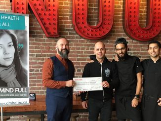Noodlebox representatives with a cheque for the Canadian Mental Health Association